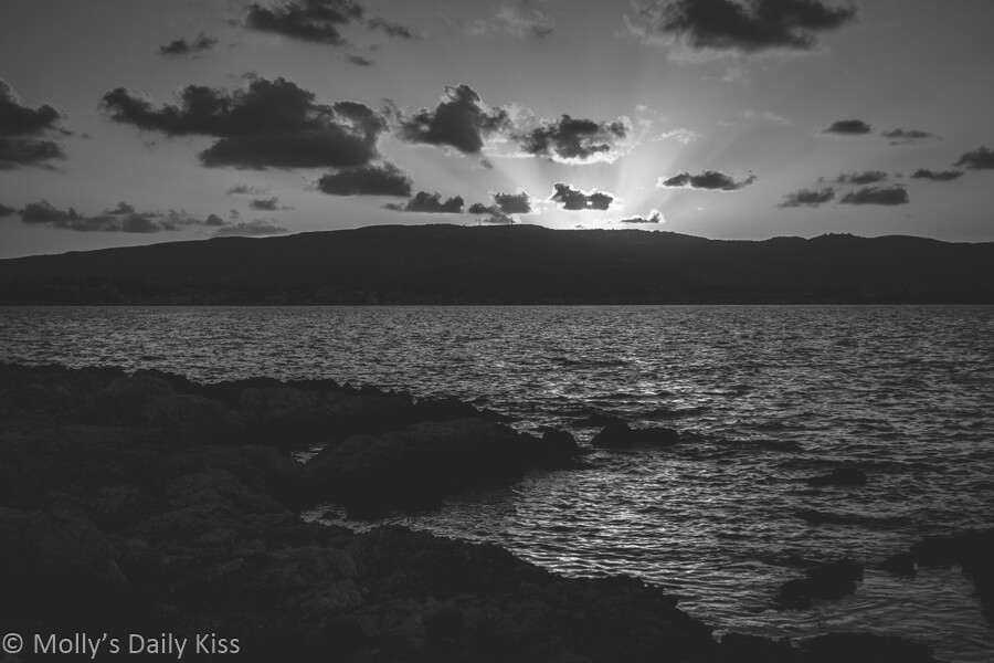 black and white sunset over the sea, cliche