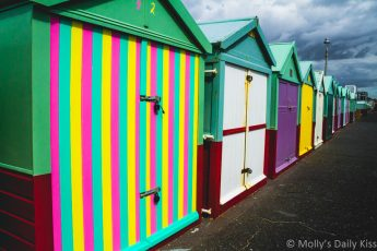 Colourful beach huts create colour harmony on Brighton sea front