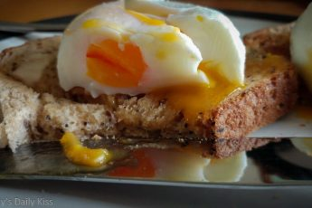 poached eggs on toast reflected in knife