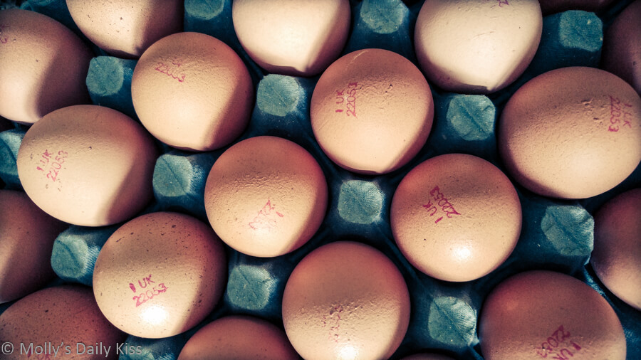 Looking down on the pattern of a tray of eggs