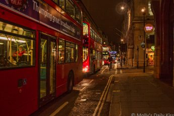 London buses in a row in the night for post called Bus Ride