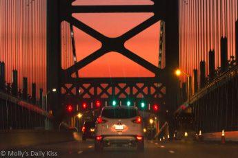 Orange sunset over Ben Franklin bridge philadelphia