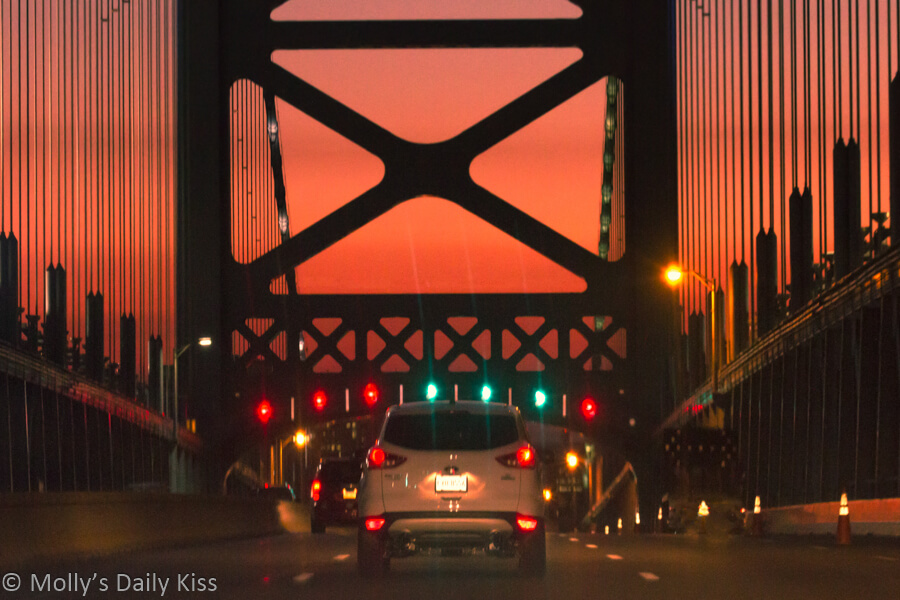 Orange sunset over Ben Franklin bridge philadelphia