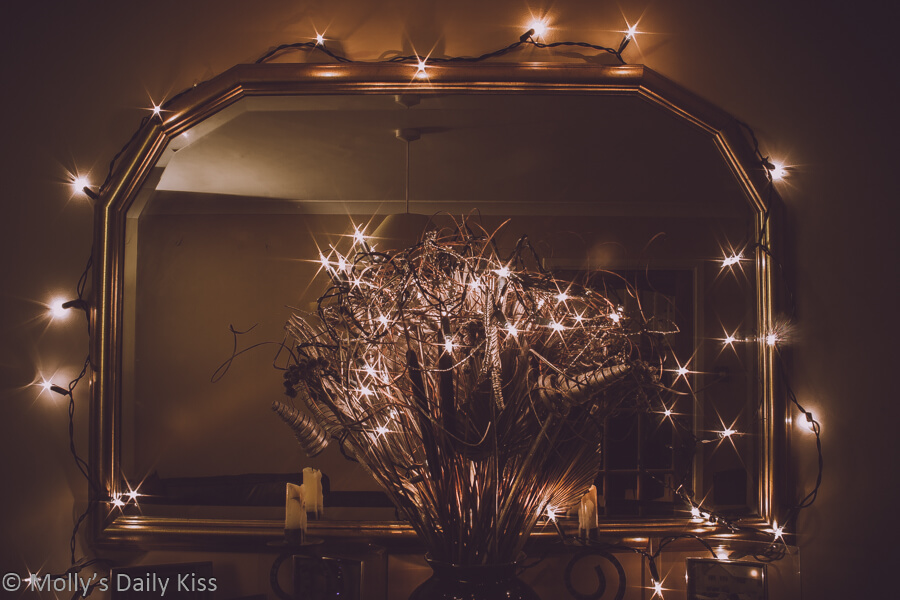Christmas fairy lights around mirror