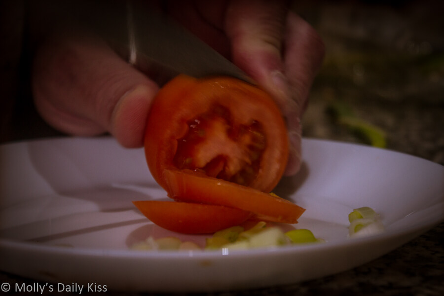 Cutting tomato fruit