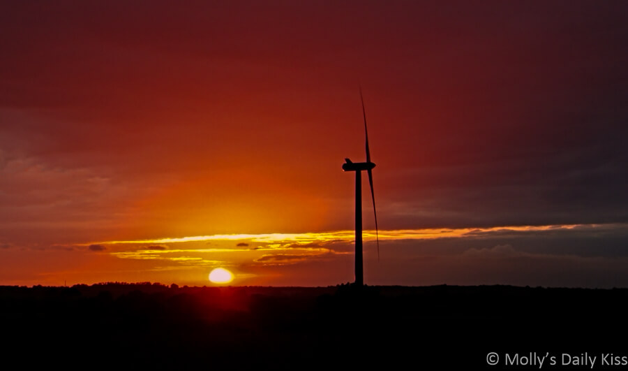Sunset with windmill silhouette