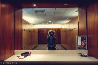 Self portrait of molly in the mirror at the locker room at the gym