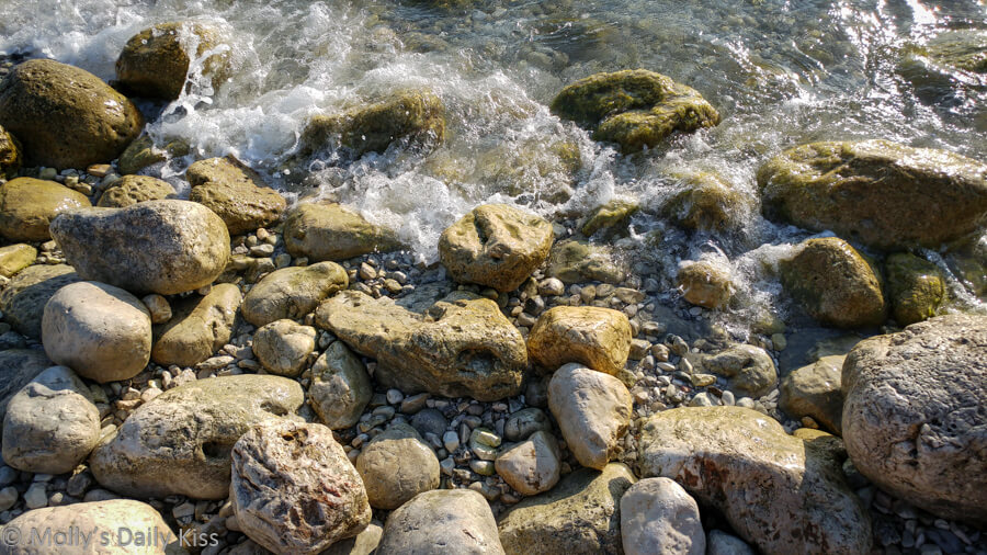 water on the shore rocks