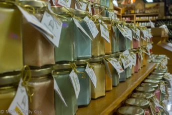 rows of jars of coloured honey