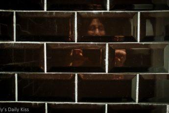 self portrait in black brick toilet wall is a bit of solitude