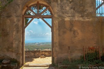 View out the door over the valley from the ruined Saint Nicolas Church Kefalonia