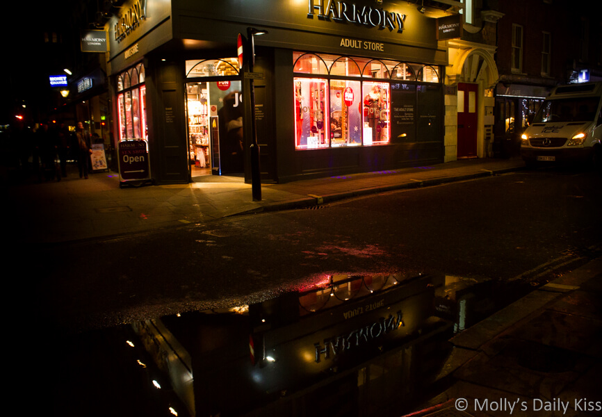 reflection of Harmony shop in London reflected in puddles