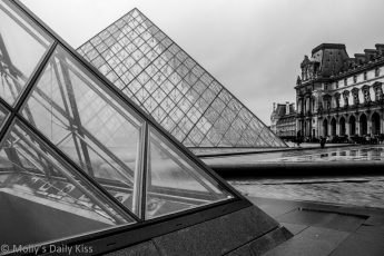 Black and white of the Louvre glass pyramid in the rain