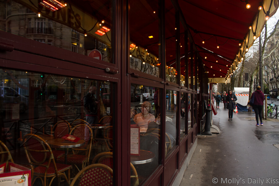 Reflection of lights and poeple in Paris cafe window