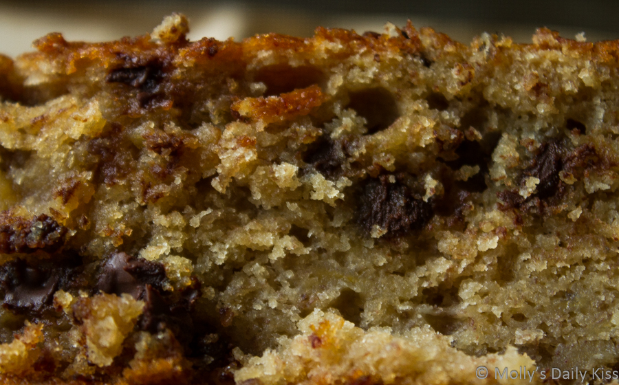 Macro shot of banana cake with choc chips in it