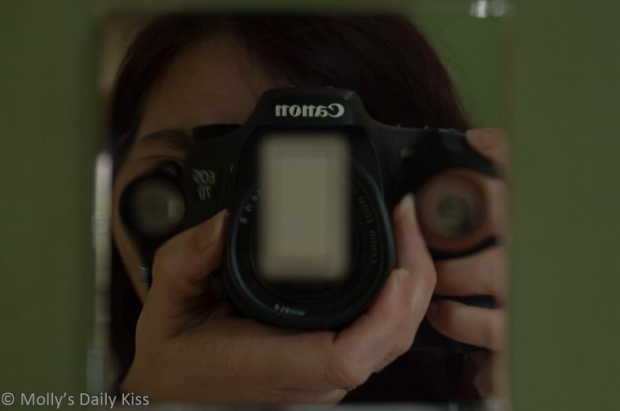 self portrait reflection in light switch