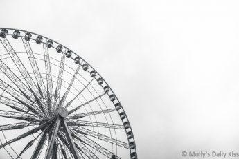 black and white image of ferris wheel in Paris against sky