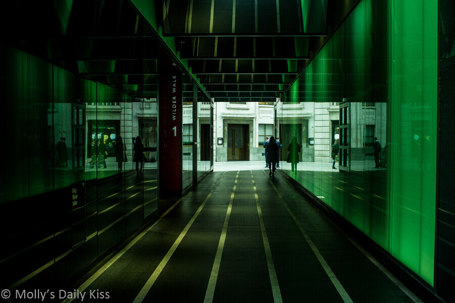 green walk tunnel under building in london is an urban form of art