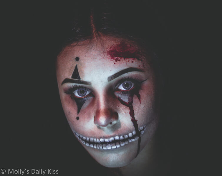 girl with painted horror face with quote by Stoker