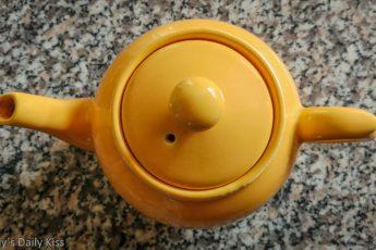 looking down on yellow tea pot
