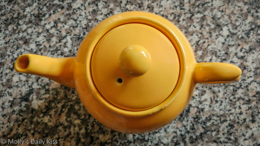 looking down on yellow tea pot