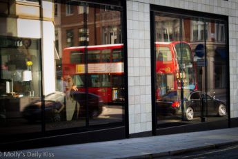 London bus reflected in shop window