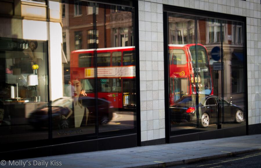 London bus reflected in shop window