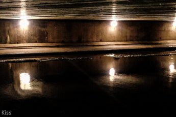 Lights in tunnel reflected in water