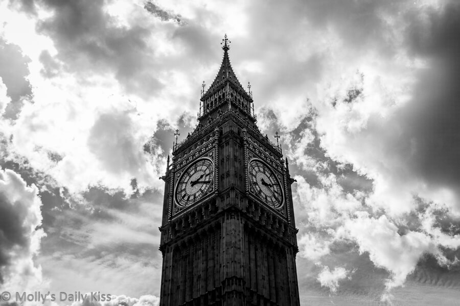 Big ben against clouds in black and white