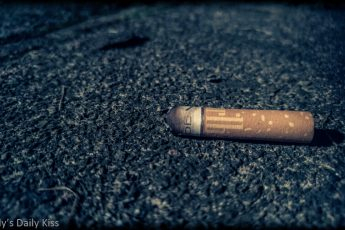 Cigarette butt laying on the ground