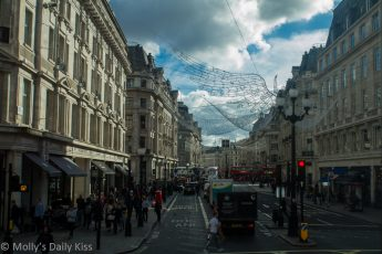 Looking south down Regents tree london towards Oxford Circus during the day busy with shoppers