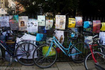 cambridge bikes up against poasters for acting theatre