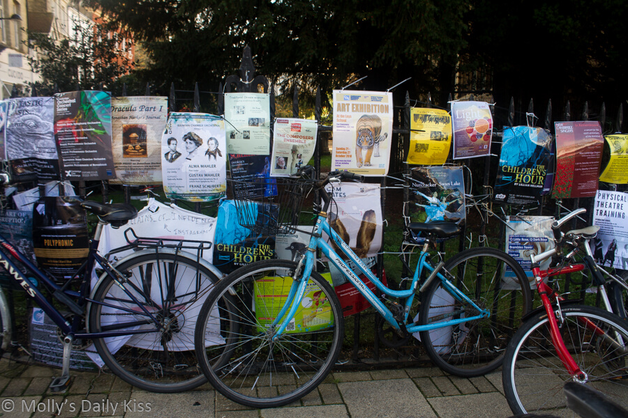 cambridge bikes up against poasters for acting theatre