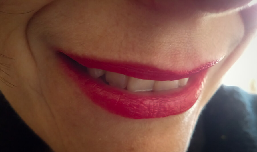 Molly's lips smiling with red lipstick