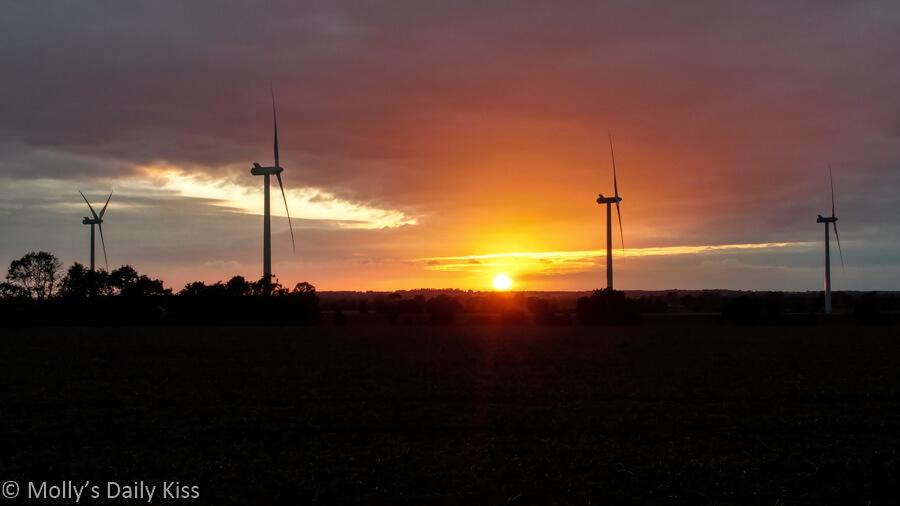 sunset with wind turbines