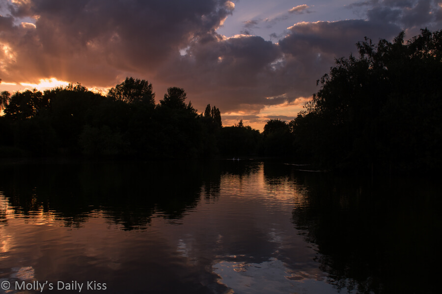 Light and dark sunset at Stanborough lakes