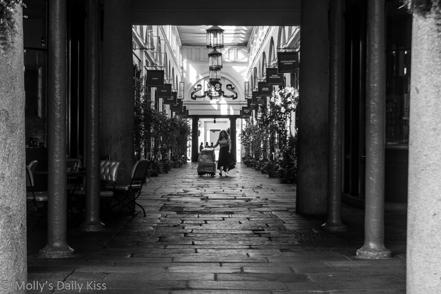 Woman with trolley in Covent Garden