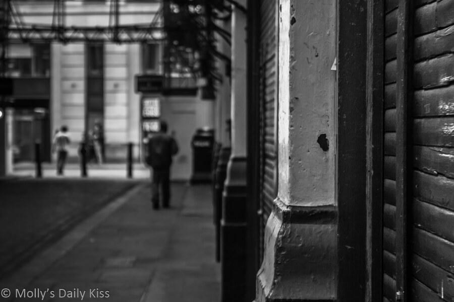 Leanenhall Market man walkigng along