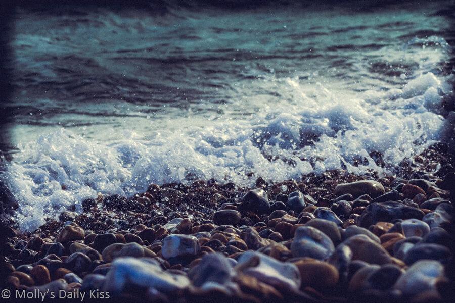 waves crashing onto pebble beach
