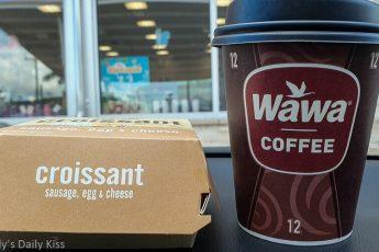 Wawa breakfast on dashboard of car