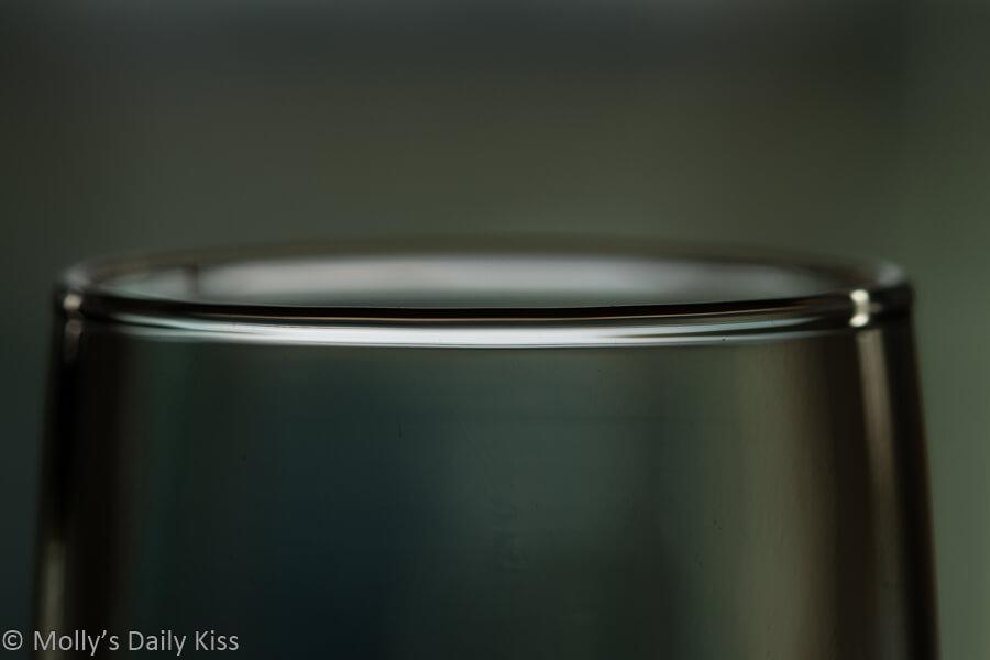 macro shot of rim of wine glass