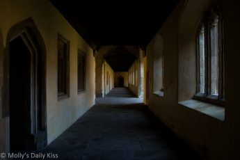 Magdelen college oxford cloisters pale with sunlight