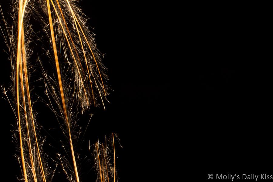 rings of sparkler sparks against black night sky