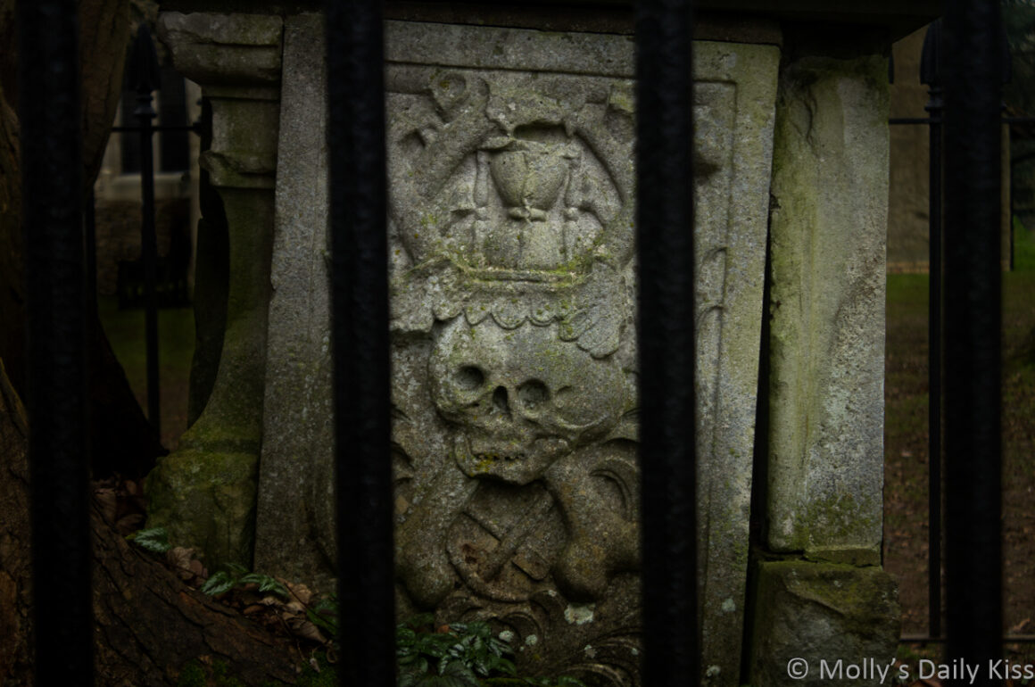 Skull and crossbones on tombstone of the dead
