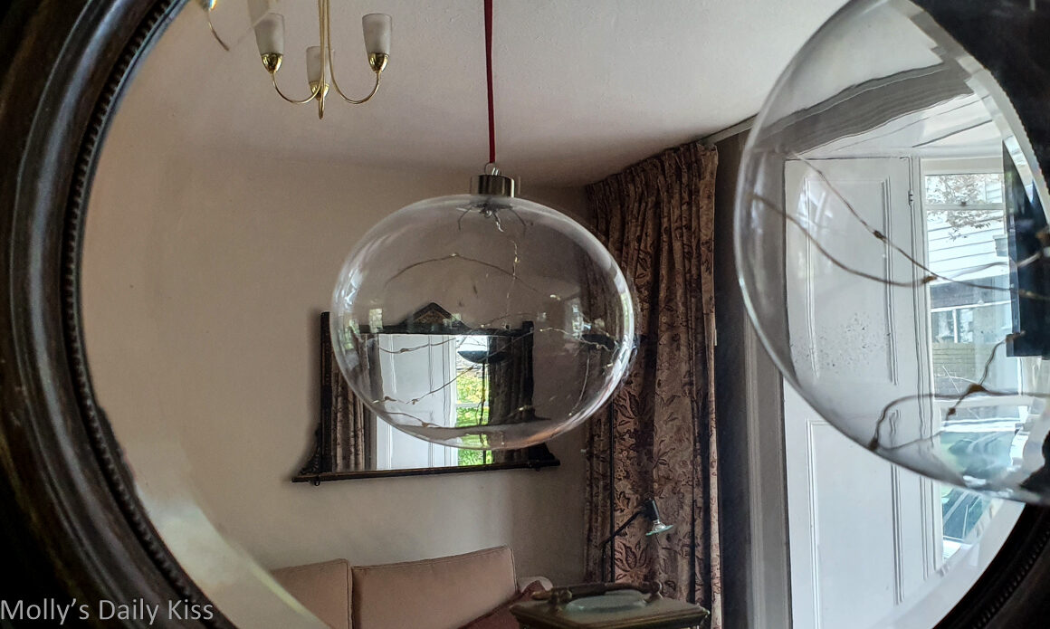glass ball reflected in mirror