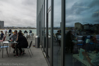 Just sit and watching people in a cafe at margate with sea in the background