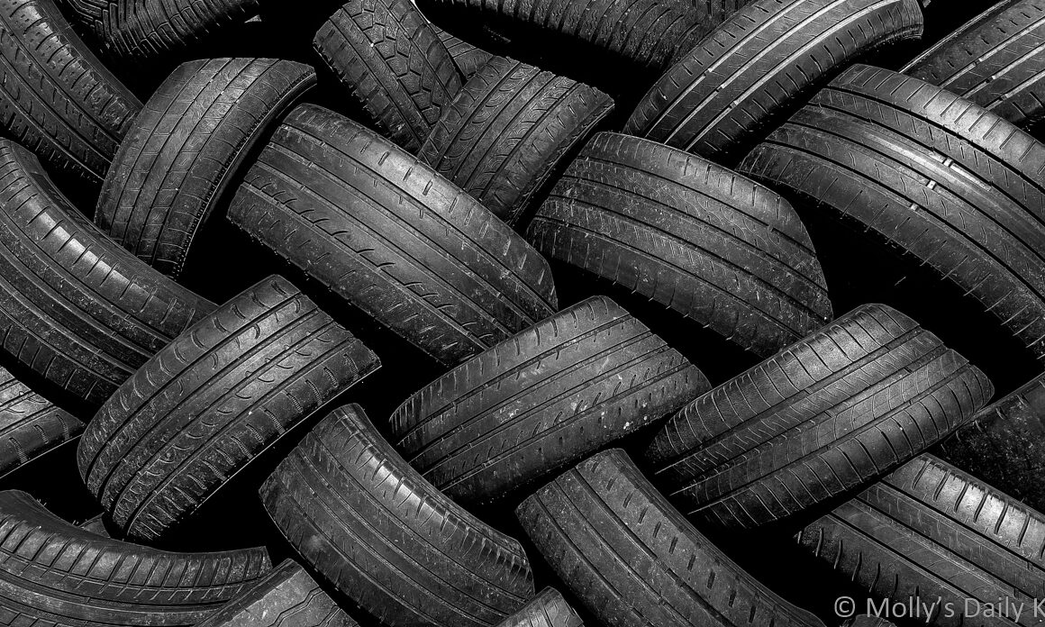 pile of tyres in black and white