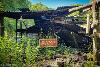 Old farm building with RAMP sign in front collapses