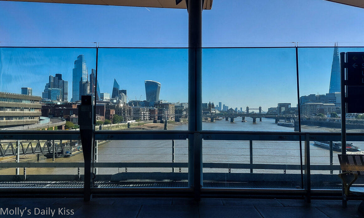 View from train down the Thames river to gallant london city